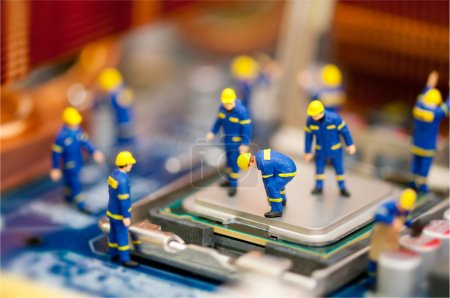 Photo for Miniature technician repairing computer - Royalty Free Image