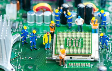 Photo for Group of miniature engineers inspecting computer processor - Royalty Free Image