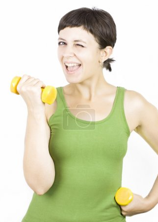 Happy young woman during fitness time and exercising lifting dumbbells