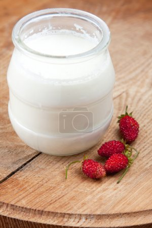 Natural yoghurt in a glass pot