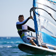 Front view of young windsurfer passing by close-up...
