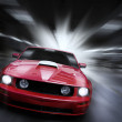 Luxury red sport car speeding in a underground par...