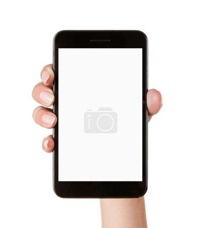 Photo pour Main féminine tenant un téléphone intelligent vide isolé sur fond blanc avec un chemin de coupure pour l'écran - image libre de droit