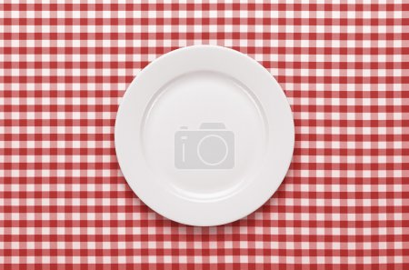 Photo for Empty plate at classic checkered tablecloth - Royalty Free Image