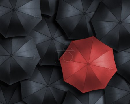 Photo for High angle view of red umbrella over many dark ones - Royalty Free Image