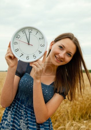 Teen girl holds watches