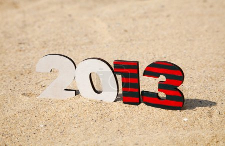 Wooden 2013 year number on the sand