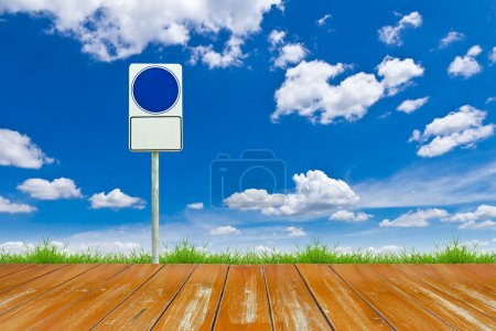 Wood way and blank sign on blue sky