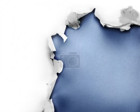 Photo for Breakthrough paper hole with blue background, isolated on white. - Royalty Free Image
