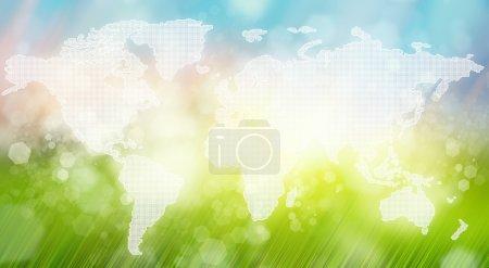 carte du monde sur fond de paysage beau matin floue