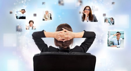 Portrait of businesswoman from behind communicating with her team