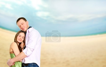 Photo for Portrait of young couple in love embracing at beach and enjoying time being together. Idealistic artistic photo poster for advertisement banner - Royalty Free Image