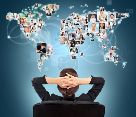 Photo for Portrait of young woman communicating with her friends across the world. Sitting against world map with photo of . International communications concept - Royalty Free Image