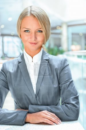 Portrait of confident business woman who is a bank worker or ins