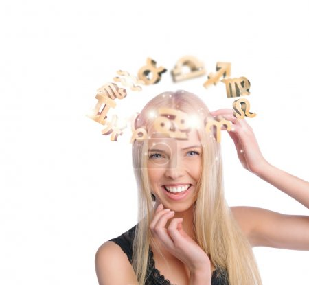Photo for Young woman with zodiac symbols flying overhead - Royalty Free Image