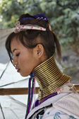 Thailand, Chang Mai, Karen Long Neck hill tribe village (Kayan Lahwi), Long Neck woman in traditional costumes. Women put brass rings on their neck when they are 5 or 6 years old and increase the numb