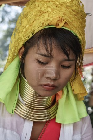 Thailand, Chiang Mai, Karen Long Neck hill tribe village (Kayan Lahwi), Long Neck woman in traditional costumes. Women put brass rings on their neck when they are 5 or 6 years old and increase the num