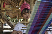Thailand, Chang Mai, Karen Long Neck hill tribe village (Kayan Lahwi), Long Neck woman in traditional costumes. Women put brass rings on their neck when they are 5 or 6 years old