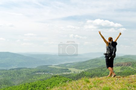 Photo for Young hiker on the hilltop. - Royalty Free Image