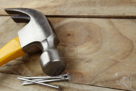 Hammer and nails on wooden decking