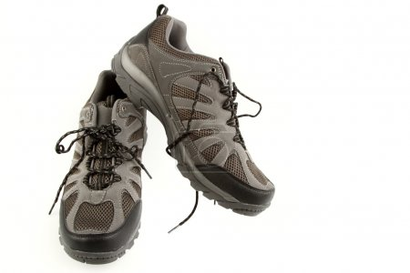 Pair of running shoes on plain background