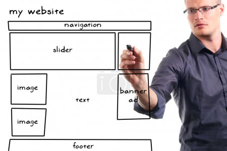 Photo for Man drawing website wireframe on the whiteboard - Royalty Free Image