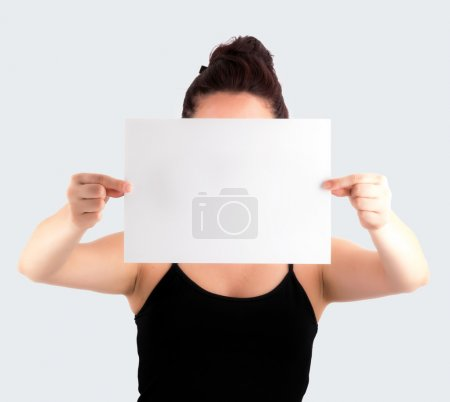 Young Casual Woman Holding a Blank Signboard - Paper with her tw
