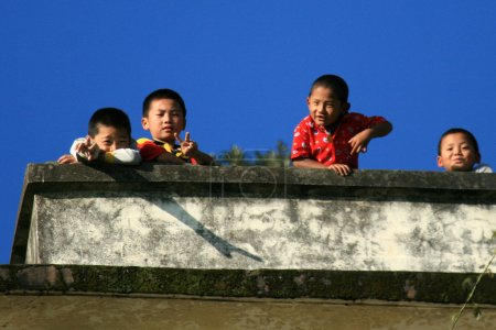 Photo for Children Playing Laughing, Trekking from Mcleod Ganj towards Dal Lake, India - Royalty Free Image