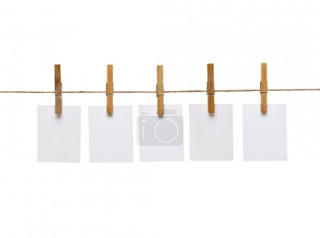 Photo for Close up of a notes and a clothes pegs on white background - Royalty Free Image
