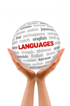 Photo pour Mains tenant une sphère de langues signent sur fond blanc - image libre de droit