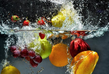 Photo for Fresh Fruit and Vegetables being shot as they submerged under water. So fresh and delicious. This idea can also be use to show washing food before being process further. - Royalty Free Image