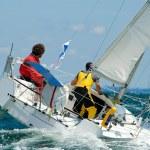 Team skipper on Yacht at race regatta