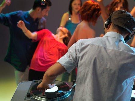 Dj playing music in night club