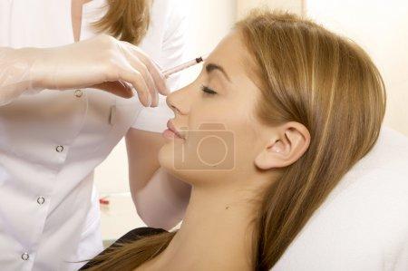 Young beautiful woman having an injection