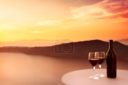Photo for 2 glasses of red wine and beautiful sunset - Royalty Free Image