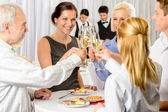 Business partners toast champagne company event