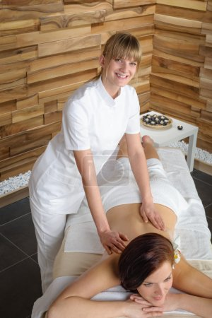 Luxury spa room masseur woman back massage