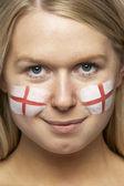 Mladí sportovní fanoušek s st georges příznak malované na obličej