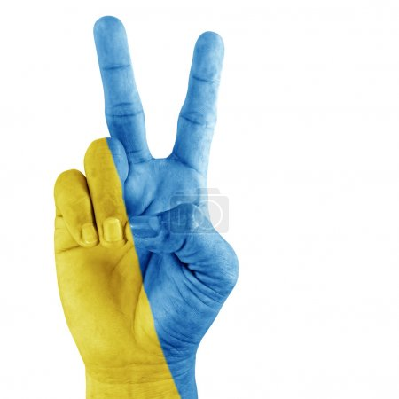 Photo pour Drapeau de l'Ukraine sur la main du geste de victoire avec fond blanc . - image libre de droit