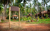 Tropical resort with signboard
