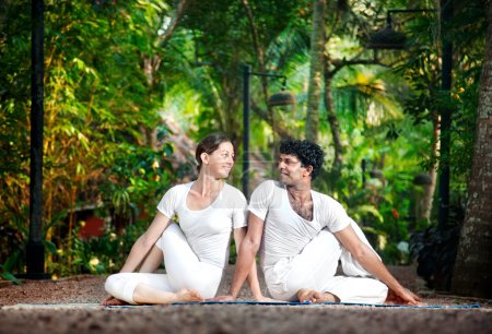 Couple yoga matsyendrasana pose