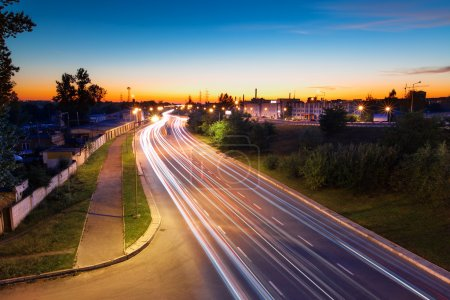 Photo for Light trails of evening highway. Urban background - Royalty Free Image
