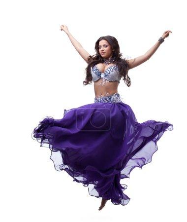 Oriental dancer in purple costume
