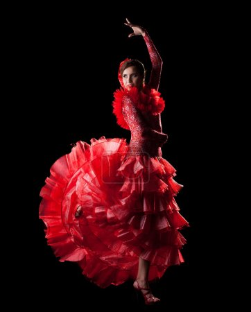 Photo for Woman dance spain flamenco in red oriental costume in dark - Royalty Free Image