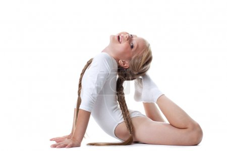 Pretty girl performing gymnastic exercises
