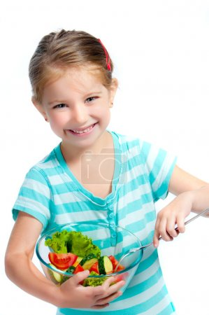 Cute little girl with a plate of salad