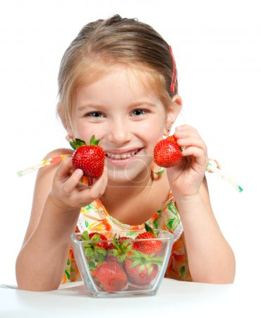 Photo for Little cute girl holding a strawberry, isolated on white - Royalty Free Image