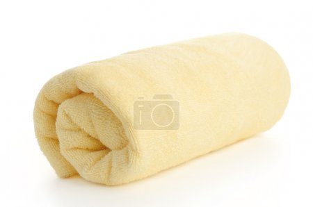 Rolled up yellow beach towel