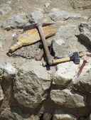Archaeologist tools on excavation site