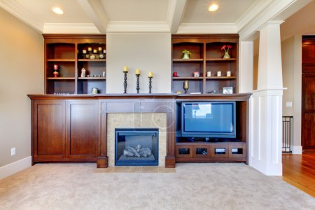 TV and entertainment center with white wood ceiling.